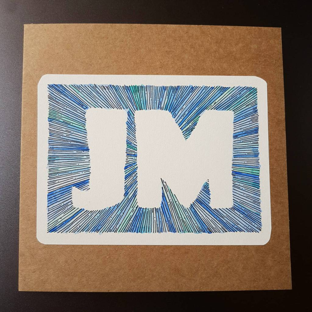 Greeting card with the initials JM made from blue lines