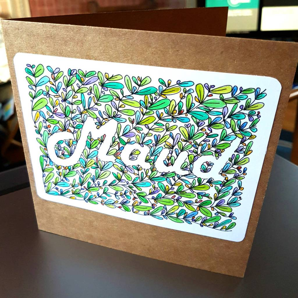 """Handmade card says """"Maud"""" in a rectangle of coloured leaves."""