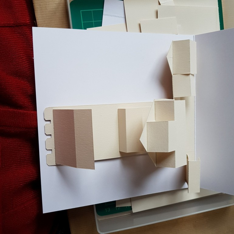 The inside back of a pop up in card before being stuck down. Rectangular shapes.