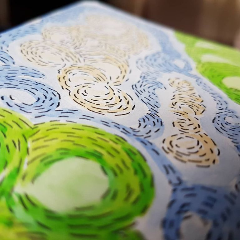 Art close up detail with green, blue and cream swirls